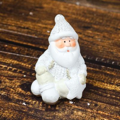 Figurka ceramiczna mikołaj siedzący 10 cm